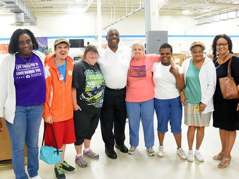 Greenwood Citizens Visit Burton Center - 8 People Smiling