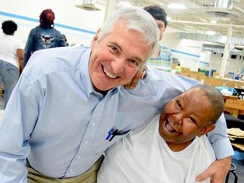 Greenwood Citizens Visit Burton Center - Friends Smiling